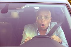 Man driving a car shocked about to have traffic accident, windsh stock images