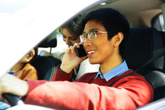 Man driving car and speaking on mobile phone Stock Photos