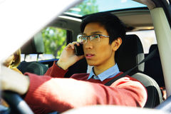 Man driving car and talking on mobile phone Stock Photography