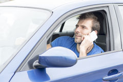 Man driving car and talking by phone, dangerous co Royalty Free Stock Image