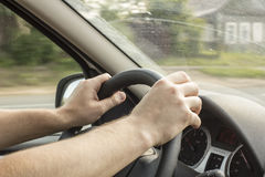 Man is driving a car to the village Royalty Free Stock Photos