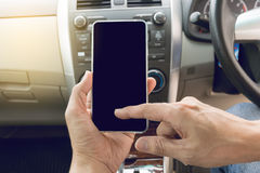 Man driving car and using mobile phone Royalty Free Stock Photography