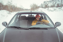 Man driving car using smart phone in car Royalty Free Stock Photo