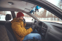 Man driving car using smart phone in car Royalty Free Stock Image