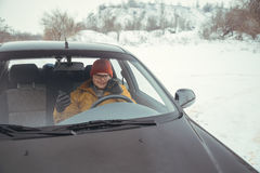 Man driving car using smart phone in car Royalty Free Stock Photos