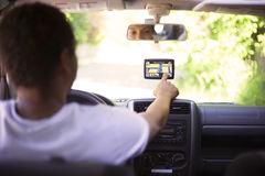 Man driving and changing GPS informations Royalty Free Stock Photos