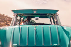 Man driving a classic car Stock Images