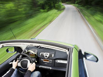 Man driving a electric car. Motion blur shot of a young man driving a electric car Stock Photography