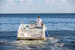 Man driving a fast boat Stock Photo