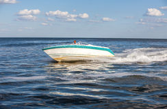 Man driving a fast boat Stock Photography