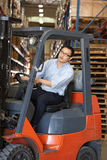 Man Driving Fork Lift Truck In Warehouse. Working Stock Photo