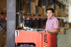 Man Driving Fork Lift Truck In Warehouse Stock Photos