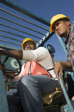 Man Driving Forklift With Co-Worker Royalty Free Stock Photo