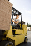 Man Driving Forklift Loader Royalty Free Stock Photos