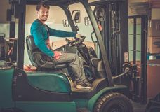 Man driving forklift truck Royalty Free Stock Photography