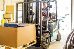 Man driving forklift truck Stock Photo