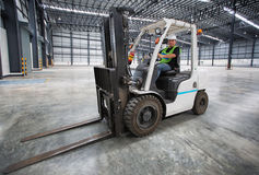 Man driving a forklift Royalty Free Stock Photos