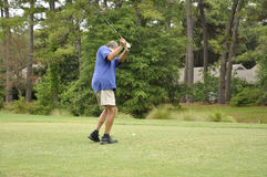 Man driving a golf ball stock images