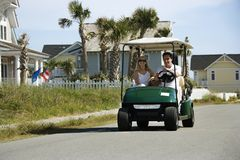 Man driving golf cart Royalty Free Stock Photography