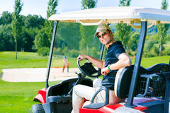 Man Driving A Golf Cart Stock Image