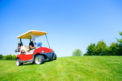 Man Driving A Golf Cart Royalty Free Stock Images