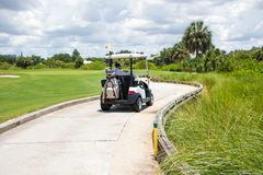 Man Driving Golf Cart on Path Royalty Free Stock Photos