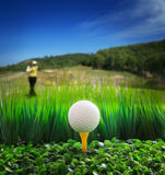 Man driving golf and close up of golf ball on gree Royalty Free Stock Photos