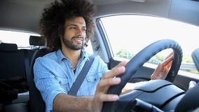 Man driving happy listening music in car stock footage