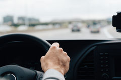 Man driving his car on the freeway royalty free stock image