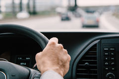 Man driving his car on the freeway stock photography