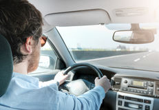 Man driving his car in in an highway Royalty Free Stock Photos