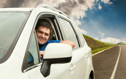 Man driving his car on the lonely road Royalty Free Stock Photography