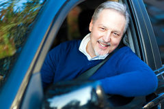 Man driving his car Stock Photos