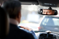 Man driving his car. In the traffic Stock Photos