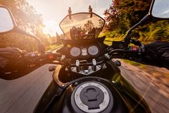 Man driving his motorcycle on asphalt country road Royalty Free Stock Photo