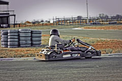 A man driving a kart Royalty Free Stock Photos