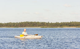 Man is driving kayak in water Royalty Free Stock Image