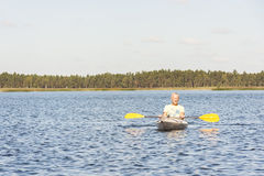 Man is driving kayak in water Stock Images