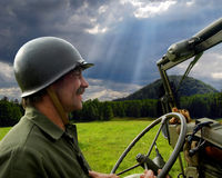 Man driving military jeep Royalty Free Stock Photos