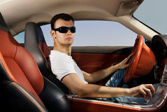 Man driving modern sport car. Handsome young man driving modern sport car royalty free stock image
