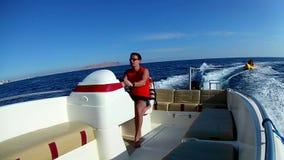 Man driving motor boat stock footage
