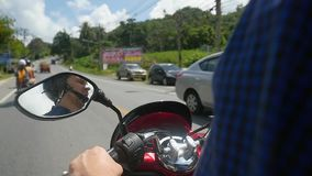 Man driving motorbike on tropical island in slow motion while traveling. Thailand. 1920x1080. Man driving motorbike on tropical island in slow motion while stock video