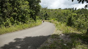 Man driving a motorcycle on mountain road stock footage
