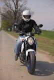 Man driving motorcycle Stock Photos