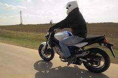 Man driving motorcycle Stock Photo