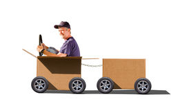 Man driving moving day boxes. A man is driving moving day boxes, illustratiing a fun approach to the tedious task of moving and the joy of hiring a good moving Stock Images