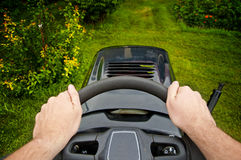 Man driving a mower tractor - point of view Royalty Free Stock Photo