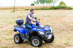 Man driving off-road with quad bike Stock Photo