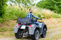 Man driving off-road with quad bike Stock Photography