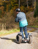 Man driving on off-road runabout. Man driving on runabout in forest terrain Royalty Free Stock Photography